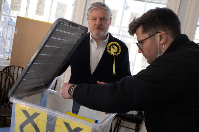 Angus Robertson (left) of the Scottish National Party prepares his campaign sheets on 14 April 2021 in the Edinburgh Center, Scotland constituency.