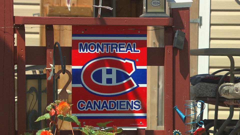 A poster of the Montreal Canadiens displayed in front of a trailer.
