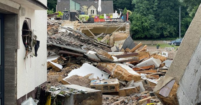 Heavy rains and floods kill at least 21 in Germany.  Dozens of people are reported missing