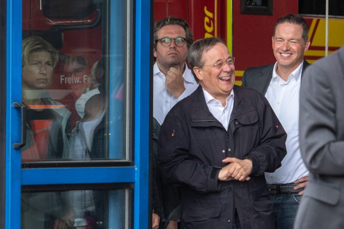 Uproar over top politician Lashet smiling during his visit.