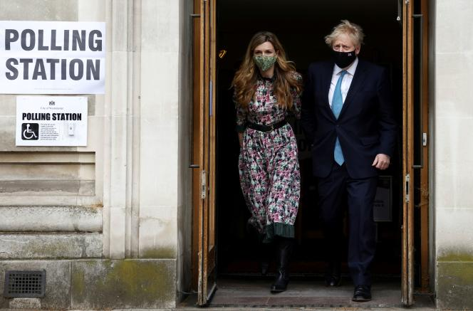 British Prime Minister Boris Johnson and his partner Carrie Symonds leave the Westminster polling station after voting on May 6, 2021 in London, Great Britain.