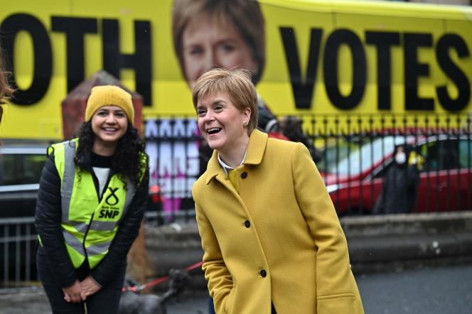 Scotland's First Minister Nicola Sturgeon (right) meets with voters outside a polling station in Glasgow, Scotland, on May 6, 2021.