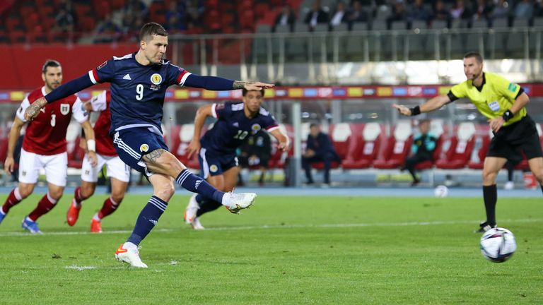Scotland's Lyndon Dykes scores a penalty to bring the score to 1-0 in the FIFA World Cup qualifier between Austria and Scotland at the Ernst-Happel-Stadion