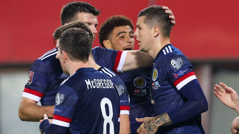 Scotland's Lyndon Dykes (right) celebrates his 1-0 success in the FIFA World Cup qualifier between Austria and Scotland at the Ernst-Happel Stadium