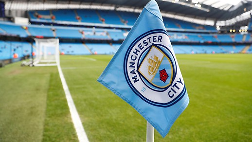 The image shows the Manchester City logo on a corner flag.