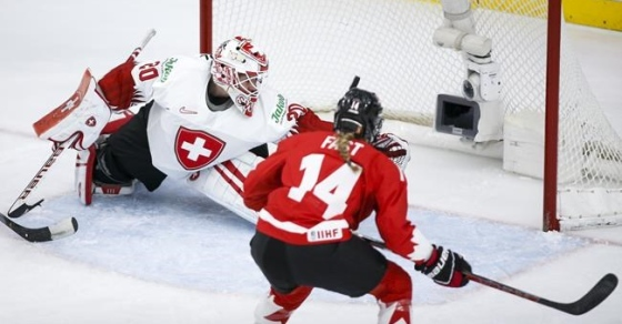 Canada defeated Switzerland 4–0 to face the United States for world women's hockey gold.