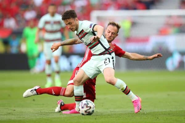BUDAPEST, HUNGRY - JUNE 15: Diogo Jota of Portugal clashes with Gergo Lovrencic of Hungary during the UEFA Euro 2020 Group F match between Hungary and Portugal at Puskas Arena on the 15th (Photo by Alex Livesey - UEFA / UEFA Getty Images) Through)
